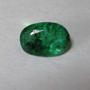 Batu Mulia Zamrud Oval 0.70 carat Berserat dan Inklusi