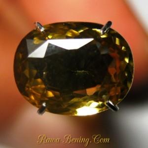 Batu mulia zircon alami 2.67 carat, bentuk oval warna kuning oranye